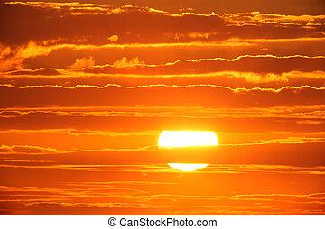 Scenic orange sunset sky background.