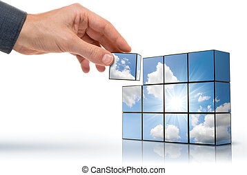 hand building up a sunny sky with white clouds