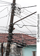 Tangled wires an electric pillar