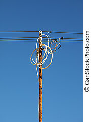 Tangled wires on power pole