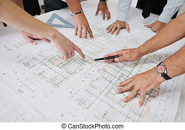 Team of architects people in group on construction site check documents and business workflow