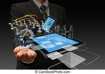 Technology in the hand of businessmen on dark background