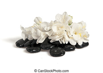 Rocks, flowers, fans and towels on white background
