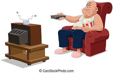 The man in an armchair watches TV