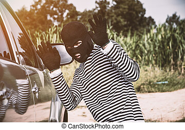 Thieves are about to steal cars.
