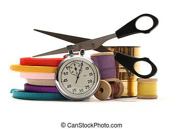 Thread bobbins, stopwatch, scissors and reels of ribbon