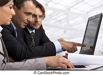 three business people working