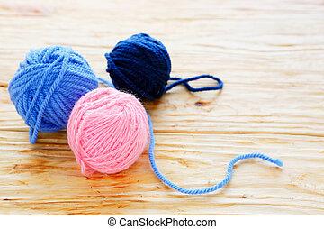 three tangle of colored thread
