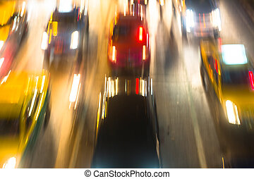 Traffic on a highway at night in big city. Abstract blurred, out of focus.