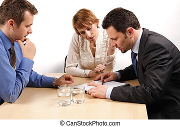 two business men and one woman over the contract