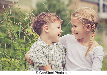 Two happy children playing in park