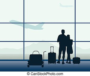 Two passengers with luggage standing in an airport hall with a flying plane and blue sky and mountains in the background