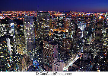 Urban city architecture. New York City Manhattan skyline aerial view with Empire State Building and Times Square at sunset.