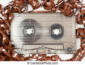 Vintage audio cassette with messed up audio tape