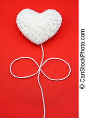 White heart shape made from wool