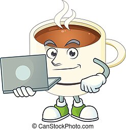 With laptop a cup coffee in the morning