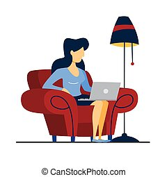 Woan sitting on the armchair and working.