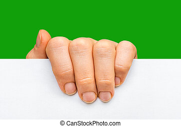 Woman's hand holding white blank paper - isolated on green