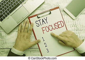 Writing note showing Stay Focused. Business photo showcasing Be attentive Concentrate Prioritize the task Avoid distractions.