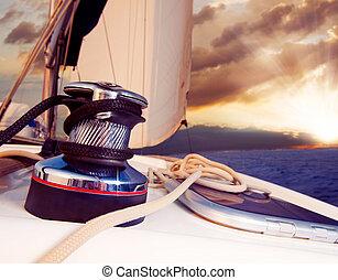 Yacht Sailing against sunset. Sailboat. Travel