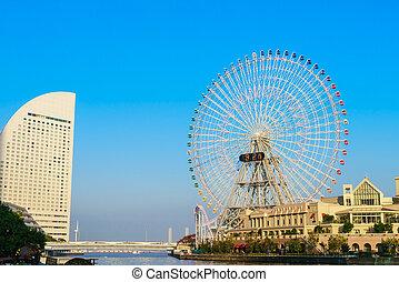 Yokohama, Japan - November 24,2015 : Ferris wheel at cosmo world fun park at minato mirai , Yokohama is the third biggest city in Japan.