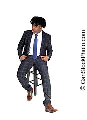 Young good looking black man sitting on chair