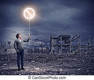 Young man and stop sign