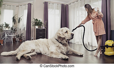 Young woman cleaning big cute dog